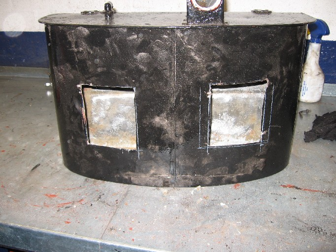 Austin Seven Chummy fuel tank opened up for steam cleaning and resealing