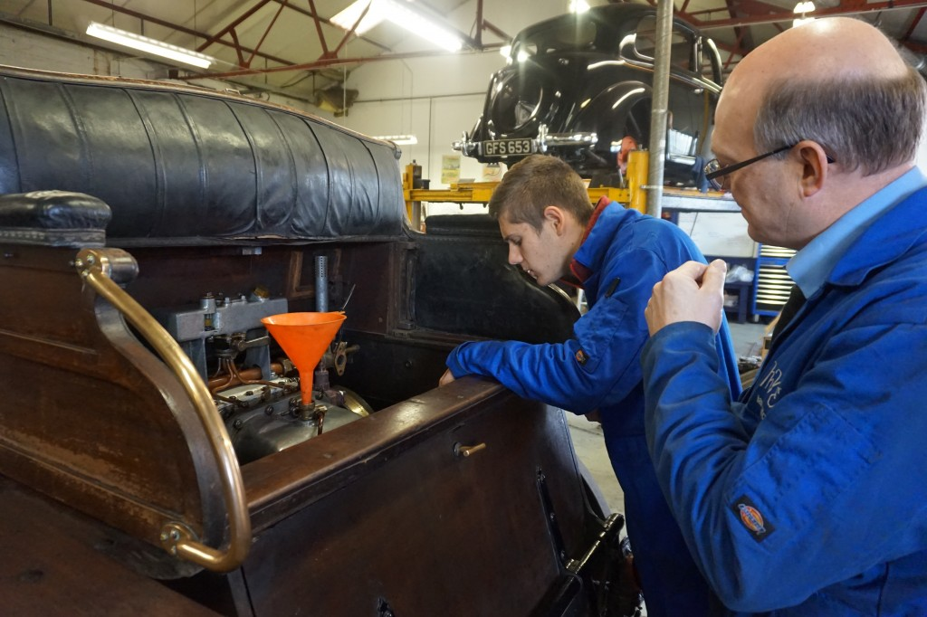 Ian explains the intricacies of  servicing this car to our French work experience student