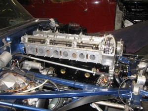 E-type engine back in position awaiting cam covers and inlet manifold