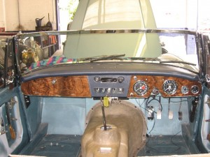 Continuing fitting up - dash back in place and new blue trim going in