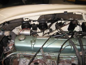 Engine bay showing poor wiring, etc