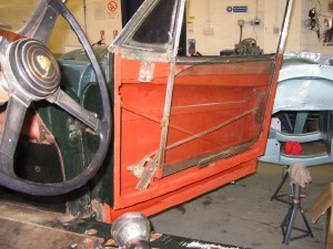 XK140 door - corrosion has been dealt with and it is now painted in rust-inhibiting primer