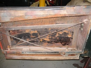 XK140 interior of door with corrosion visible