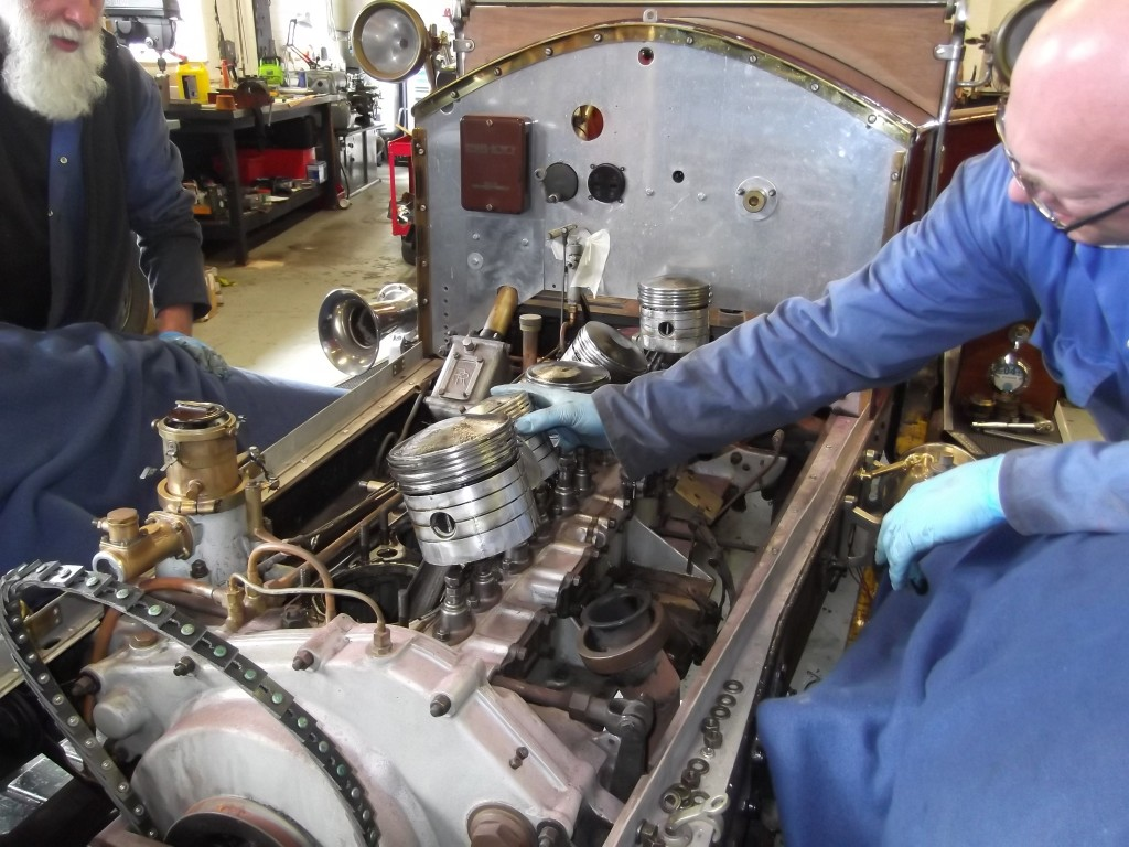 Starting to strip the engine - a quick look at the pistons before removal